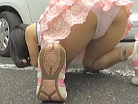Hot bodied Asian teen in a tiny pink skirt is playing with the tennis ball in the street. Trying to get it from under the car she goes on the knees and bends over uncovering thrilling booty upskirt!