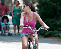 Girl on bike up the skirt