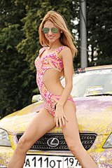 0999 Girl-in-sexy-bikini-poses-at-car